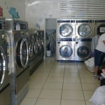 Staff working hard washing and drying your laundry.